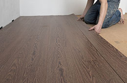 man installing wood floor
