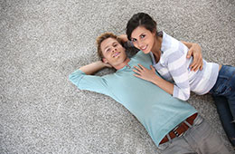 couple laying on carpet together