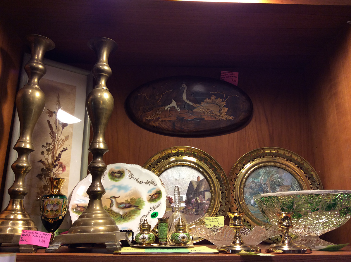 antique candle sticks and paintings