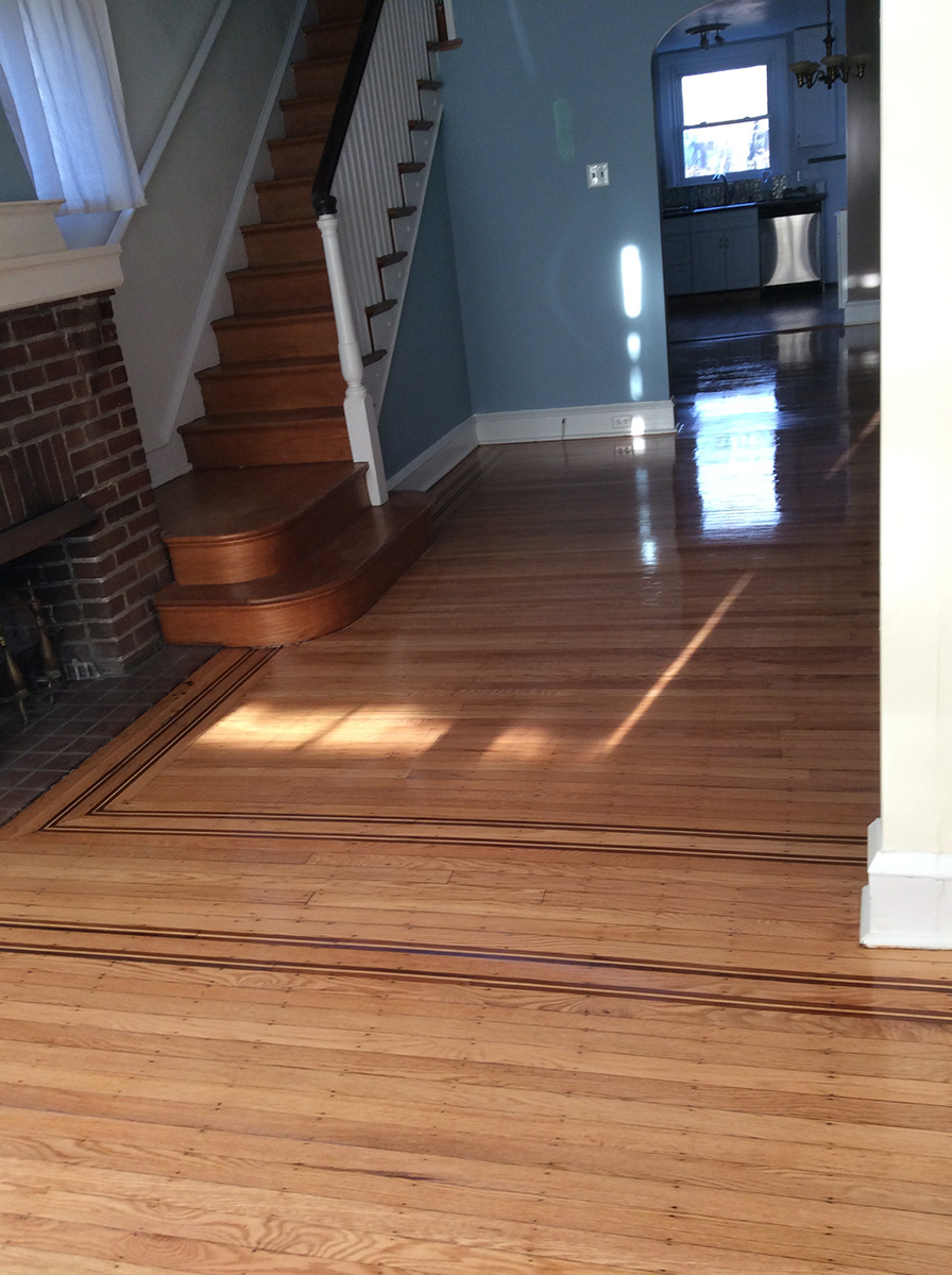 living room with refinished wood floor