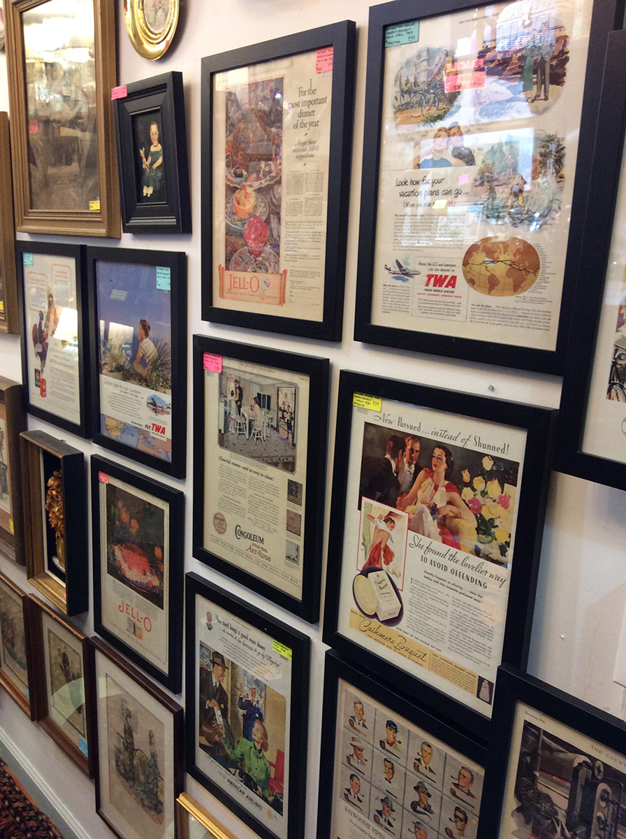 old magazine pages framed hanging on a wall