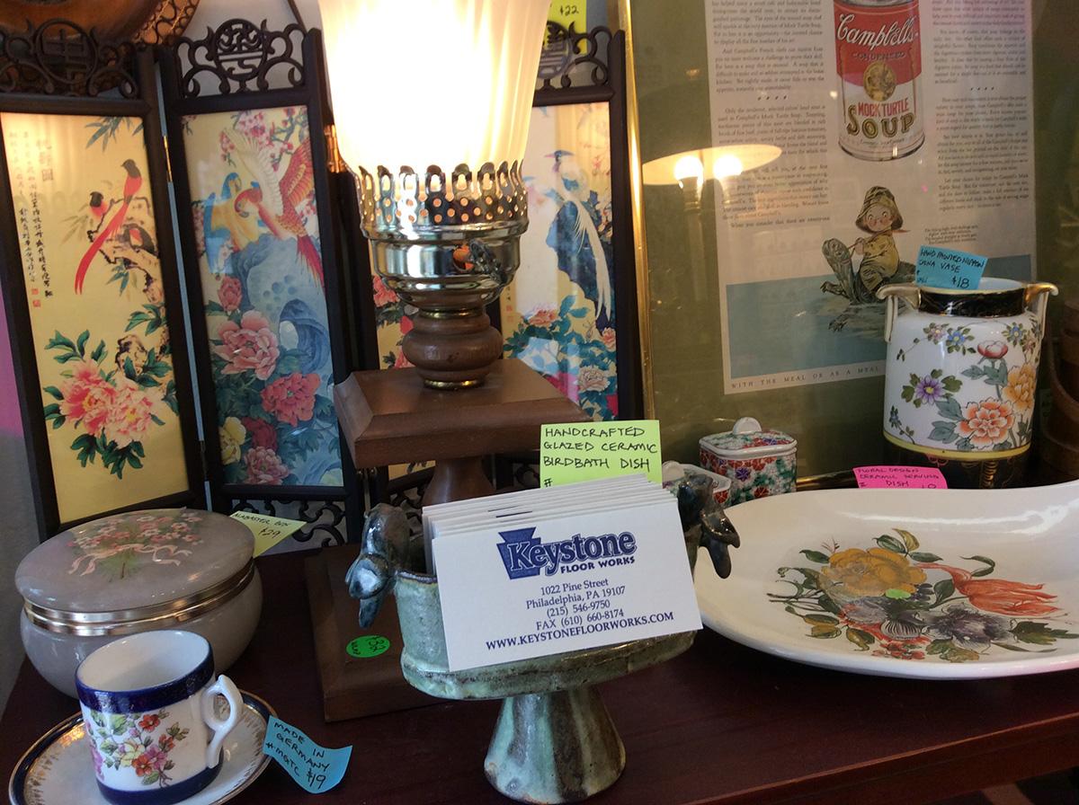 keystone floor works business cards & ceramic art on a table