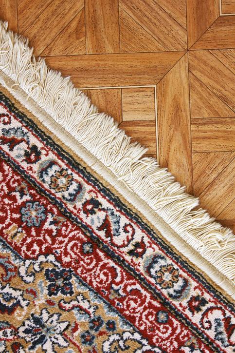 carpet on top of a wood floor